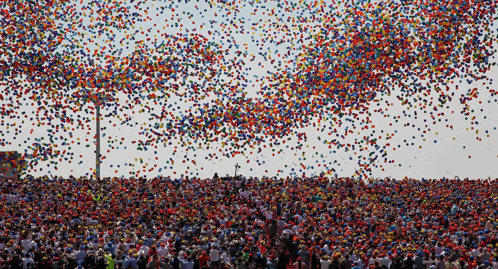 Balloons are released as a crowd looks up during a military parade over Tiananmen Square in Beijing on September 3, 2015, to mark the 70th anniversary of victory over Japan and the end of World War II