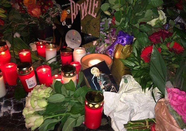 Fans gathered Monday night outside the Berlin apartment where British musician David Bowie lived in the 1970s.  Bowie passed away on Sunday after an 18-month battle with cancer.