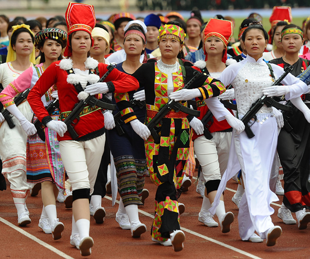 Ethnic minorities female militia parade during official celebrations of the 60th anniversary of Vietnam's Dien Bien Phu victory over France at a stadium in the Northwestern town of Dien Bien Phu on May 7, 2014