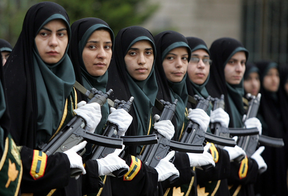 Iranian policewomen parade during a female police graduation ceremony at the Police Academy in Tehran, 11 March 2006