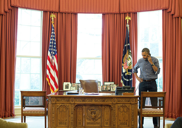 President Barack Obama talks on the phone in the Oval Office with Russian President Vladimir Putin about the situation in Ukraine, March 1, 2014