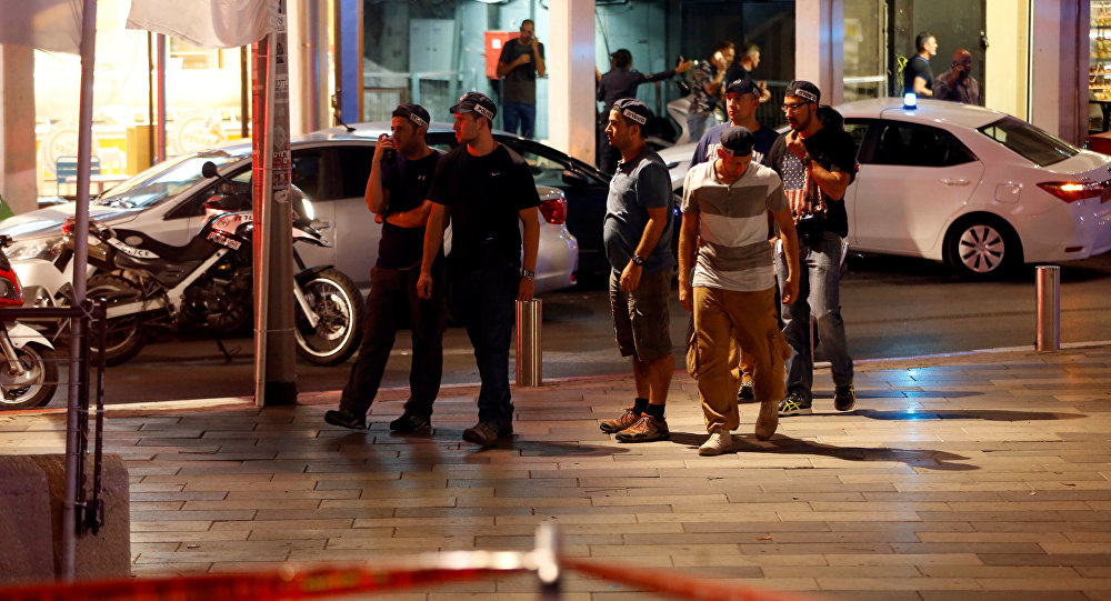 Israeli security personnel secure the area where a shooting attack took place in the center of Tel Aviv.