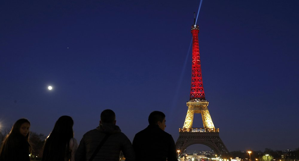 The Eiffel Tower is seen with the black, yellow and red colours of the Belgian flag in tribute to the victims of today's Brussels bomb attacks in Paris.