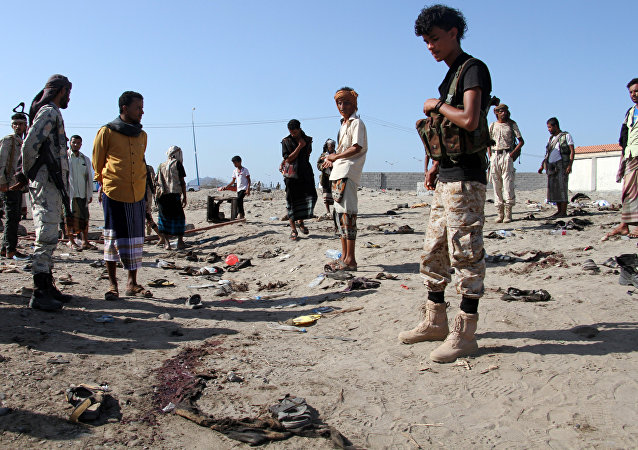 Yemenis gather at al-Sawlaba base in Aden's al-Arish district on December 18, 2016, after a suicide bomber targeted a crowd of soldiers