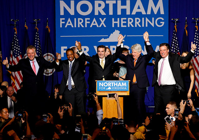 Virginia Governor Elect Ralph Northam (C) celebrates with, left to right, Gov. Terry McAuliffe, Lt. Governor Elect Justin Fairfax, Attorney General Mark Herring and Sen. Mark Warner (D-VA), at his election night rally on the campus of George Mason University in Fairfax, Virginia, November 7, 2017. REUTERS/Aaron P. Bernstein