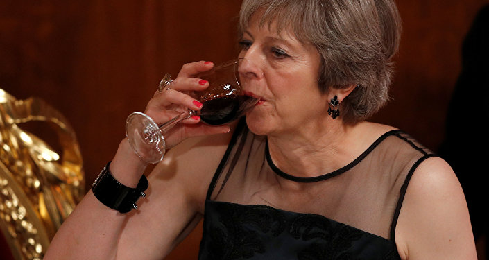 Britain's Prime Minister Theresa May drinks a toast at the Lord Mayor's Banquet at the Guildhall, in London, Britain