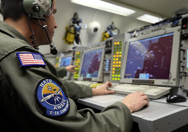 A controller monitors is seen screening aboard a NATO AWACS (Airborne Warning and Control Systems) aircraft during a surveillance flight over Romania in this April 16, 2014.
