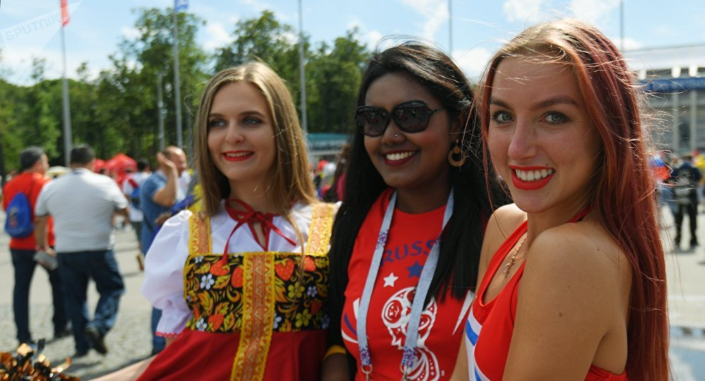A soccer fans cheer waiting for the start of the World Cup Round of 16 soccer match between Russia and Spain outside the Luzhniki stadium in Moscow, Russia, July 1, 2018