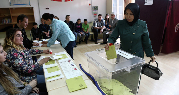 A Turkish woman casts her ballot as she votes in Turkey's general election at a polling station in a primary school in Ankara on June 7, 2015