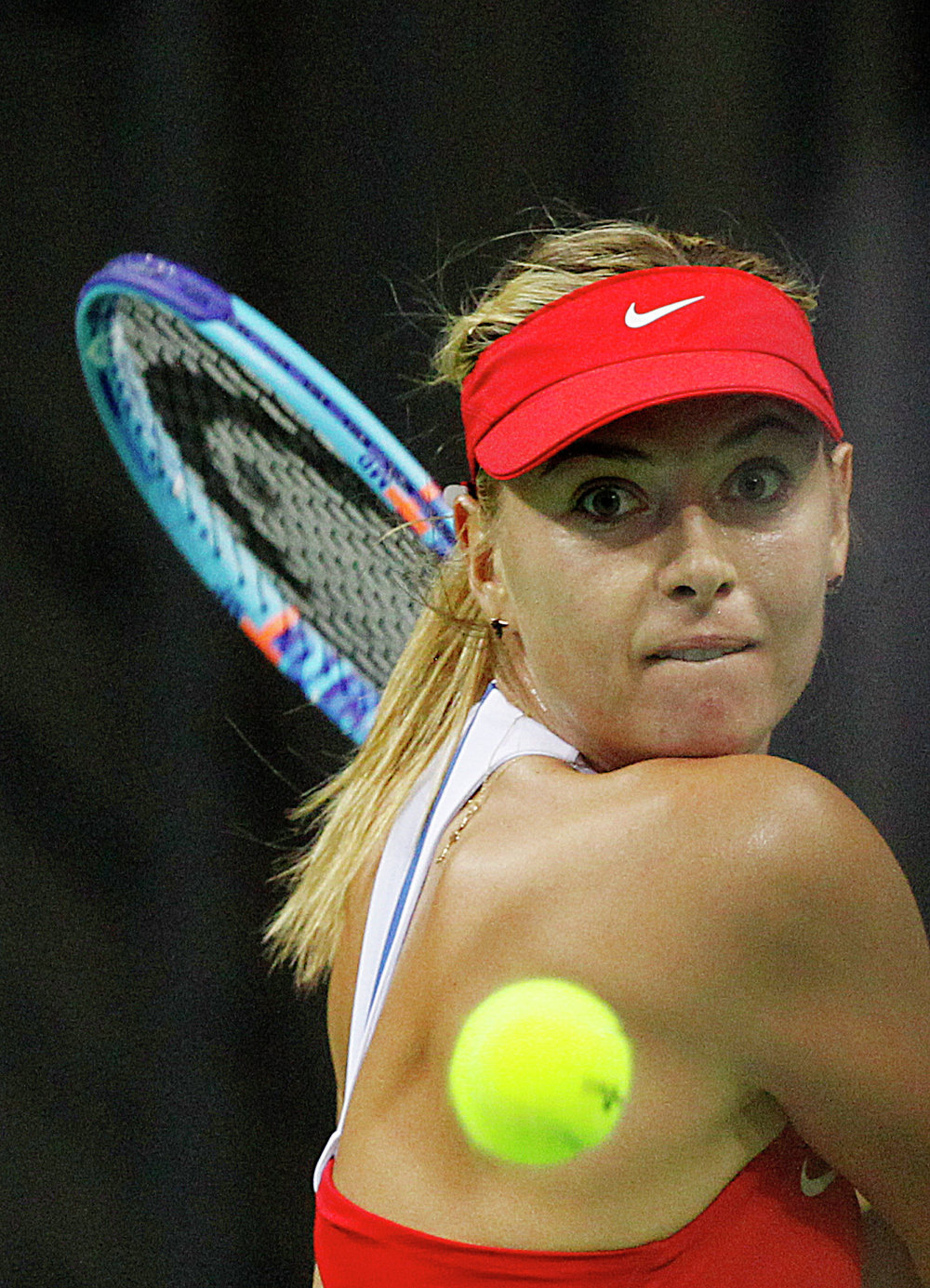 Maria Sharapova of Russia returns a ball to Agnieszka Radwanska of Poland during the Fed Cup World Group first round tennis match between Poland and Russia in Krakow, Poland, Sunday, Feb. 8, 2015
