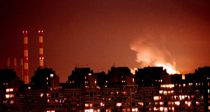 Flames from an explosion light up the Belgrade skyline near a power station after NATO cruise missiles and warplanes attacked Yugoslavia late Wednesday, March 24, 1999