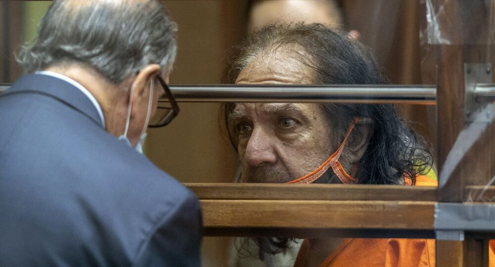 Former porn star Ron Jeremy talks with his attorney Stuart Goldfarb during his arraignment on rape and sexual assault charges
