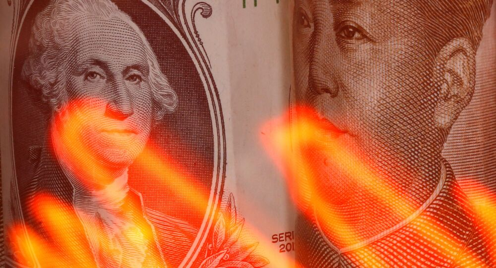 Chinese Yuan and U.S. dollar banknotes are seen behind illuminated stock graph in this illustration taken February 10, 2020.
