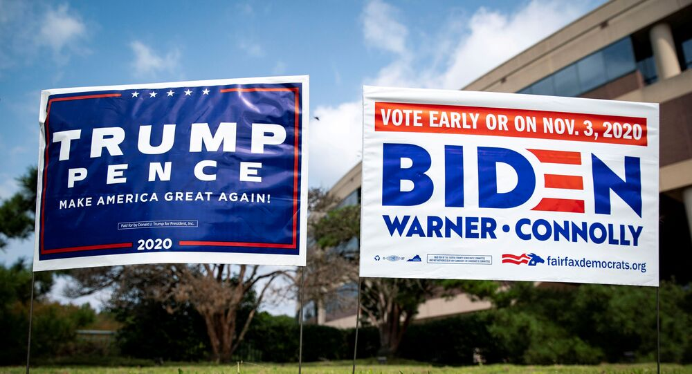FILE PHOTO: Yard signs supporting U.S. President Donald Trump and Democratic U.S. presidential nominee and former Vice President Joe Biden are seen outside of an early voting site at the Fairfax County Government Center in Fairfax, Virginia, U.S., September 18, 2020. REUTERS/Al Drago/File Photo