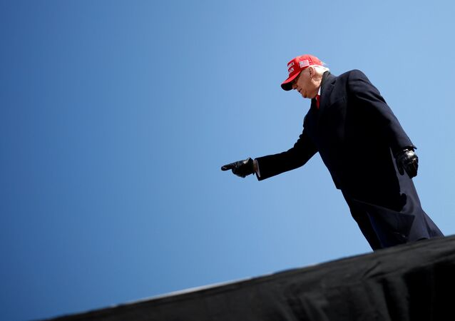 U.S. President Donald Trump gestures during a campaign rally at Fayetteville Regional Airport in Fayetteville, North Carolina, U.S., November 2, 2020. REUTERS/Carlos Barria