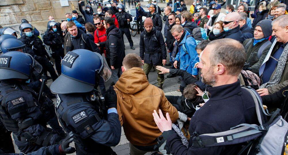 Demonstrators clash with police during a protest against the government's coronavirus disease (COVID-19) restrictions in Kassel, Germany March 20, 2021