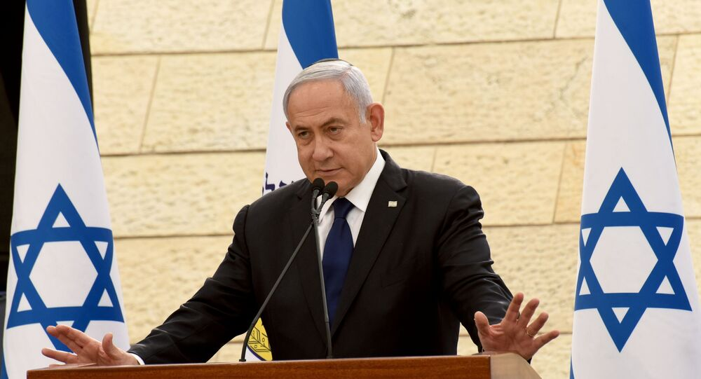 Israeli Prime Minister Benjamin Netanyahu speaks at a ceremony for fallen soldiers of Israel's wars at the Yad Lebanim House on the eve of Memorial Day, in Jerusalem, April 13, 2021