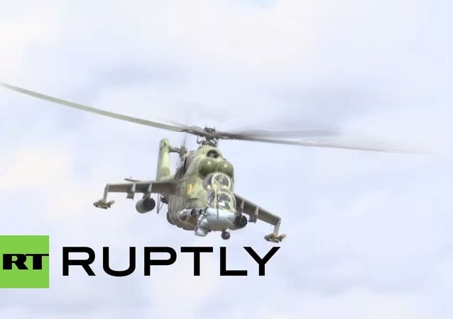 Mil Mi-24 attack helicopters guard Russia's main Syrian Air Base