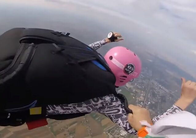 Skydiving father saves son in mid-air