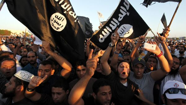 In this Sept. 21, 2012 file photo, Libyan followers of Ansar al-Shariah Brigades and other Islamic militias, hold a demonstration against a film and a cartoon denigrating the Prophet Muhammad in Benghazi, Libya - Sputnik Србија