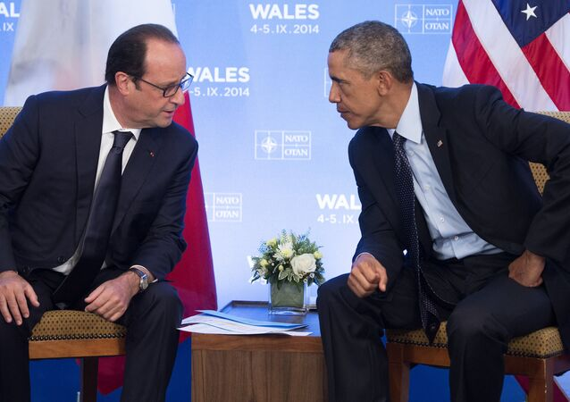 US President Barack Obama (R) and French President Francois Hollande hold a meeting on the second day of the NATO 2014 Summit at the Celtic Manor Resort in Newport, South Wales, on September 5, 2014