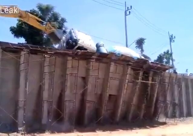 Cement Mixer Falls off Construction Ramp