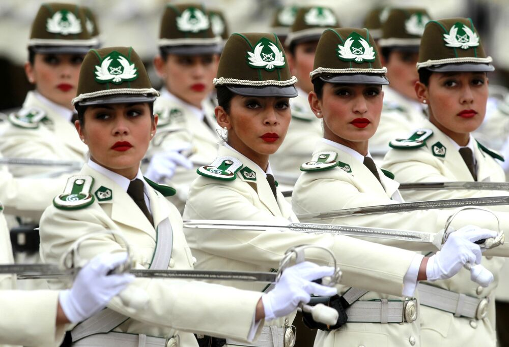 Female police officers participate in a military parade in Santiago on September 19, 2015, on the day of the 205th anniversary of Chile's independence