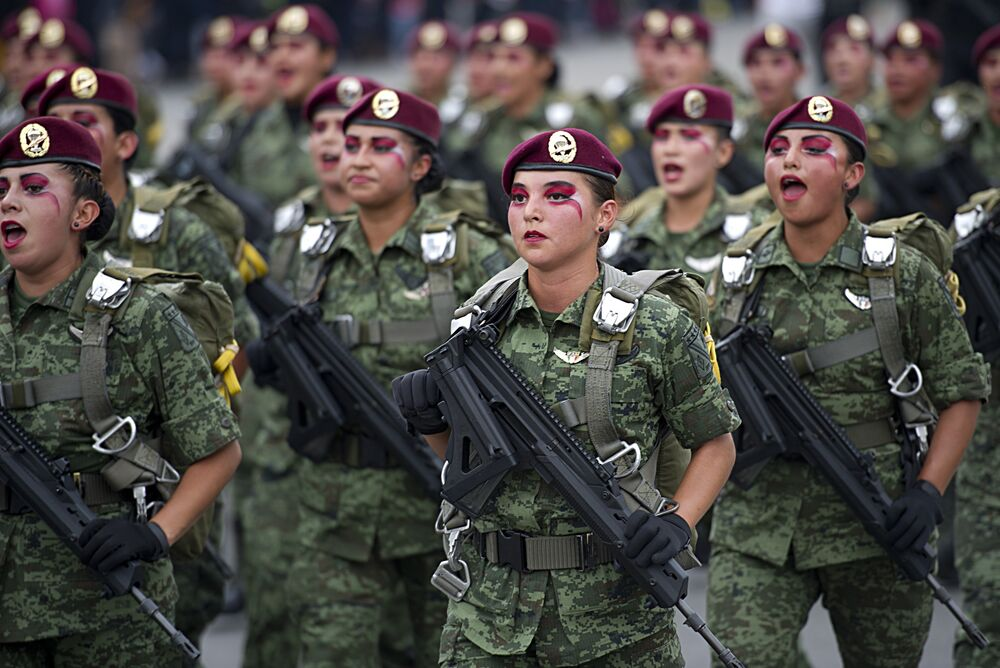 Mexican female paratroopers participate in a military parade to commemorate the 205th anniversary of Mexico's Independence, in Mexico City, on September 16, 2015