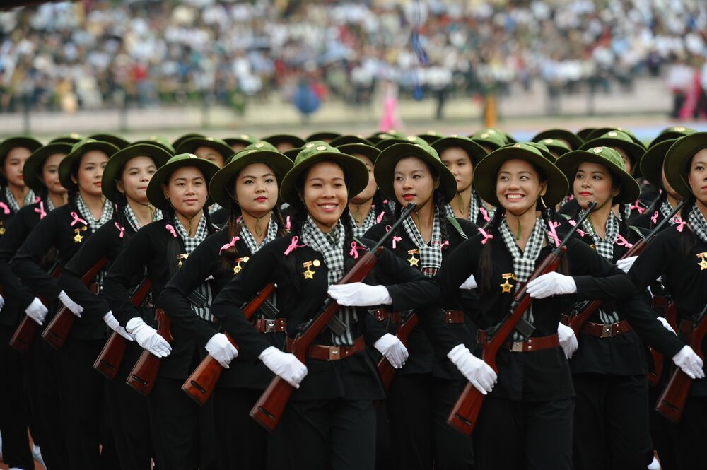 Women dressed as female Vietcong soldiers during the Vietnam war parade during official celebrations of the 60th anniversary of Vietnam's Dien Bien Phu victory over France at a stadium in the Northwestern town of Dien Bien Phu on May 7, 2014