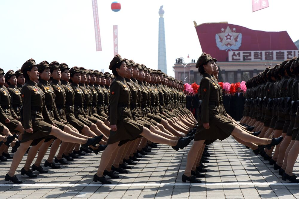 North Korean female soldiers march during a military parade to mark 100 years since the birth of the country's founder Kim Il-Sung in Pyongyang on April 15, 2012