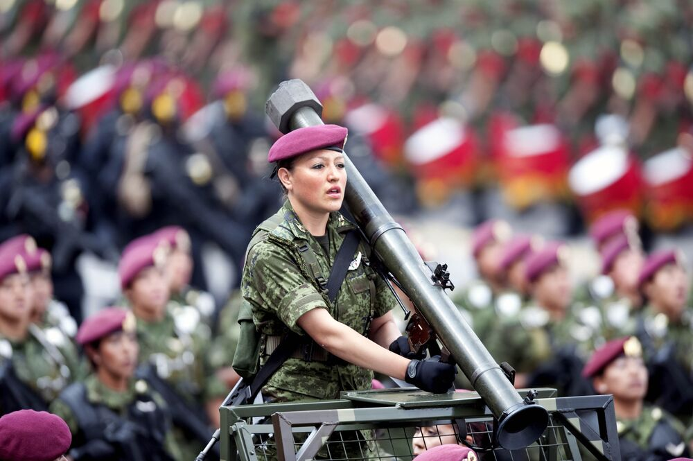 A Mexican female soldier holding an antitank rocket launchertakes part in military parade during the celebration of the 201st anniversary of the country's independence at Constitution Square in Mexico City on September 16, 2011
