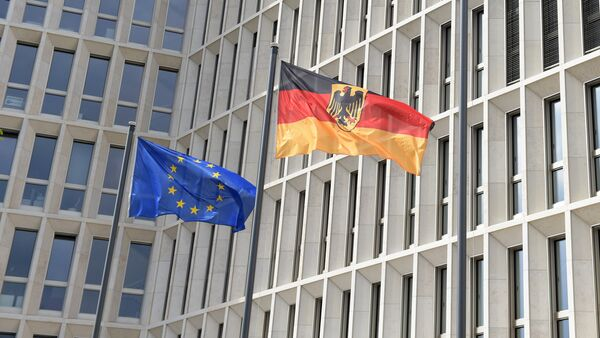 The German (R) and the European flag fly in the wind outside the new Federal Ministry of the Interior building in Berlin on April 26, 2015 - Sputnik Srbija