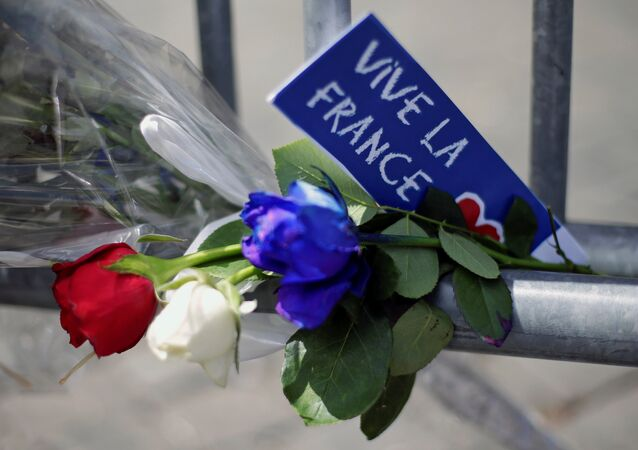 Flowers are seen attached to a fence to remember the victims of the Bastille Day truck attack in Nice in front of the French embassy in Rome.
