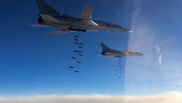 A Tupolev Tu-22M3 long-range strategic and maritime strike bomber of the Russian Aerospace Forces during a combat flight to strike the Islamic State infrastructure facilities in Syria by OFAB-25-270 fragmentation high explosive bombs - Sputnik Srbija