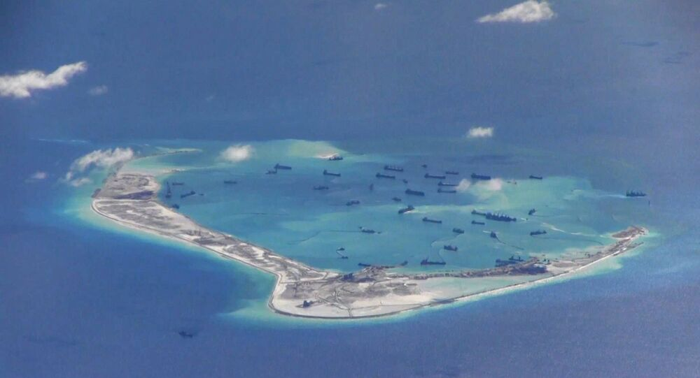 Chinese dredging vessels are purportedly seen in the waters around Mischief Reef in the disputed Spratly Islands in the South China Sea.file photo