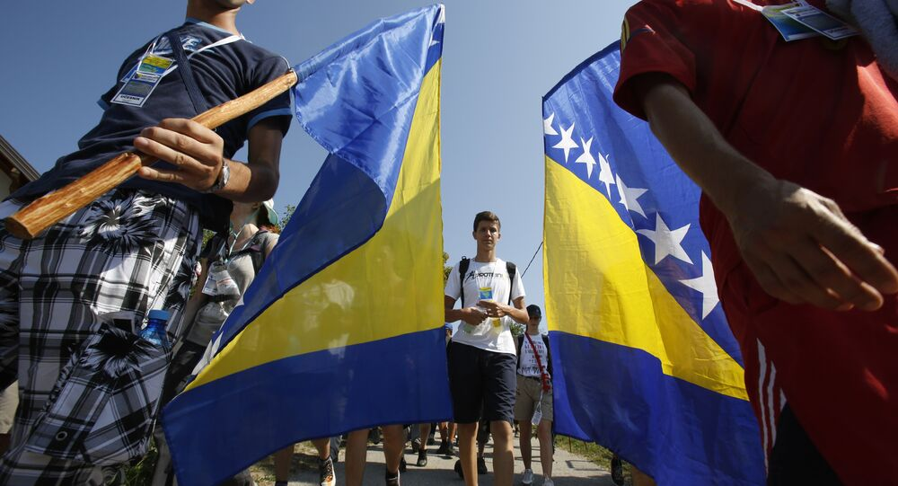 Participants in the March of Peace holding Bosnian flags, march near the village of Nezuk, 150 kms north east of Sarajevo,Bosnia, Wednesday, July 8, 2015