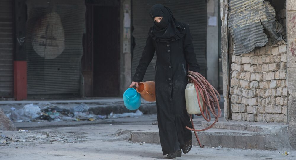 A woman walks in a residential area of Aleppo, a city divided by a front line (File)