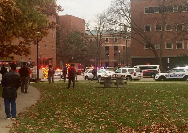 Police cars, fire truck and ambulance line 19th and College avenues near location where active shooter was reported