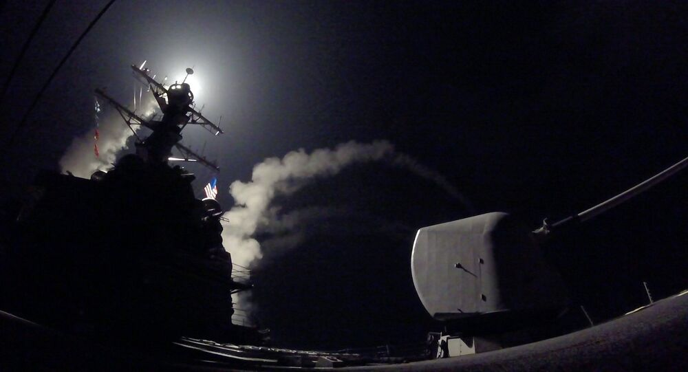 In this image provided by the U.S. Navy, the guided-missile destroyer USS Porter (DDG 78) launches a tomahawk land attack missile in the Mediterranean Sea, Friday, April 7, 2017.