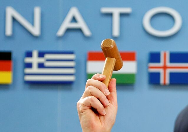 NATO Secretary-General Jens Stoltenberg holds up a ceremonial hammer at the start of a NATO-Georgia defence ministers meeting at the Alliance headquarters in Brussels, Belgium February 16, 2017.