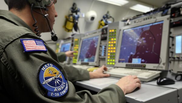 A controller monitors is seen screening aboard a NATO AWACS (Airborne Warning and Control Systems) aircraft during a surveillance flight over Romania in this April 16, 2014. - Sputnik Србија