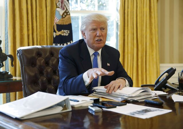 U.S. President Donald Trump is interviewed by Reuters in the Oval Office at the White House in Washington
