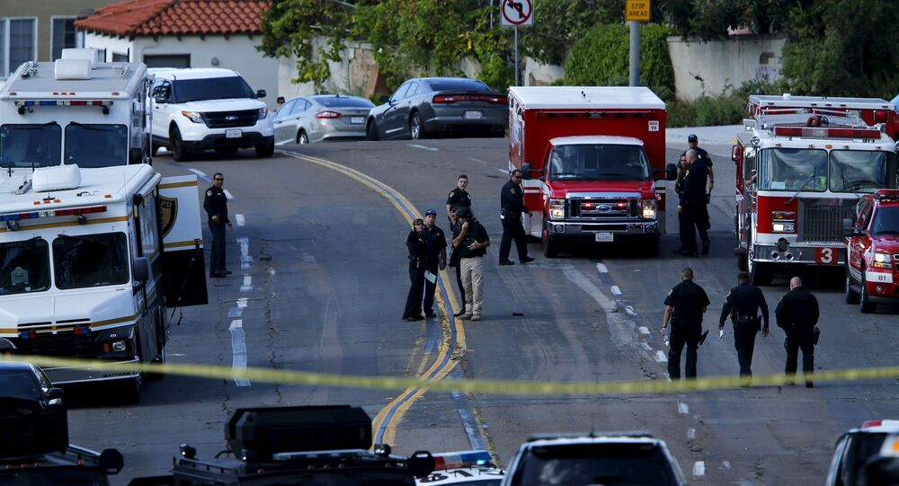 Police and fire personnel are seen at the scene of an active shooting with a suspect with a high powered rifle in the Bankers Hills section of San Diego, California, November 4, 2015.
