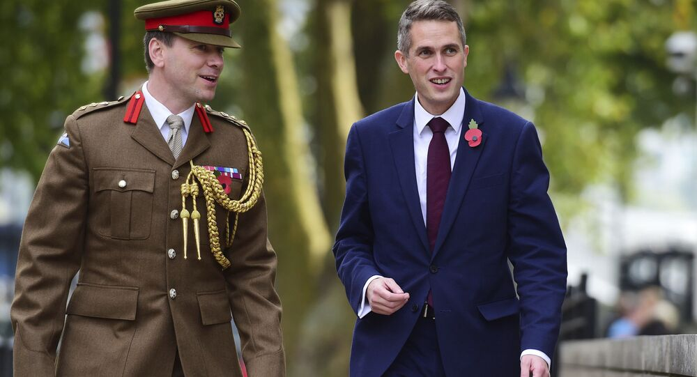 Gavin Williamson, right, outside the Ministry of Defence in London after he was named as the new Secretary of State for Defence following the resignation of Sir Michael Fallon who admitted his behaviour had fallen below the high standards required in the role, Thursday, Nov. 2, 2017.