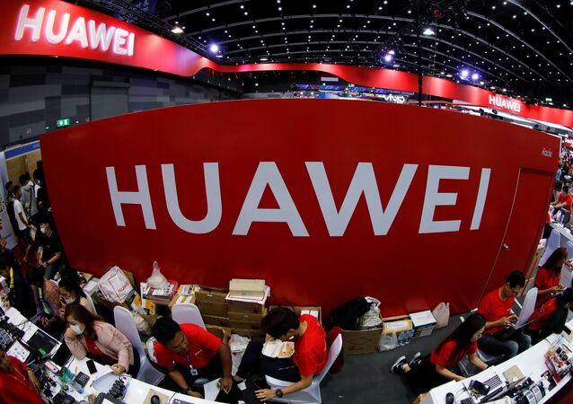 Workers sit at the Huawei stand at the Mobile Expo in Bangkok, Thailand, May 31, 2019