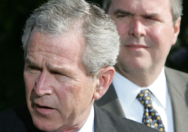President George W.Bush, left, makes a statement on the Global War on Terror, standing with his brother Jeb Bush.