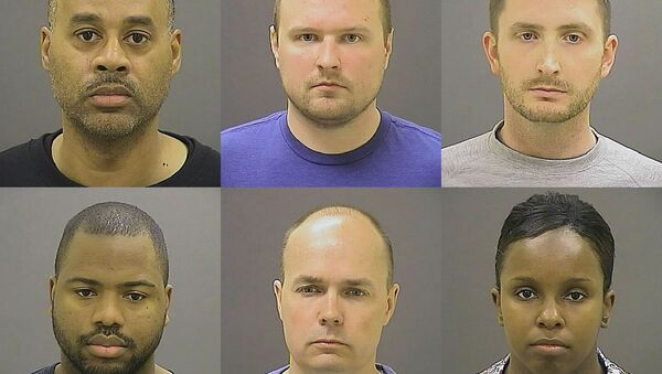 These undated photos provided by the Baltimore Police Department, show Baltimore police officers, top row from left, Caesar R. Goodson Jr., Garrett E. Miller and Edward M. Nero, and bottom row from left, William G. Porter, Brian W. Rice and Alicia D. White, charged with felonies ranging from assault to murder in the police-custody death of Freddie Gray. A grand jury indicted the six officers, State's Attorney Marilyn Mosby said Thursday, May 21, 2015. - Sputnik Србија