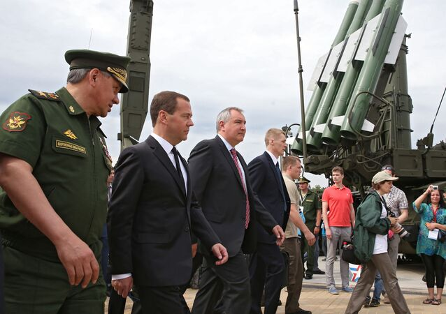 June 19, 2015. Russian Prime Minister Medvedev (center),Defense Minister Sergey Shoigu (left) and Deputy Prime Minister Dmitry Rogozin visit the ARMY 2015 International Military Technical Forum.