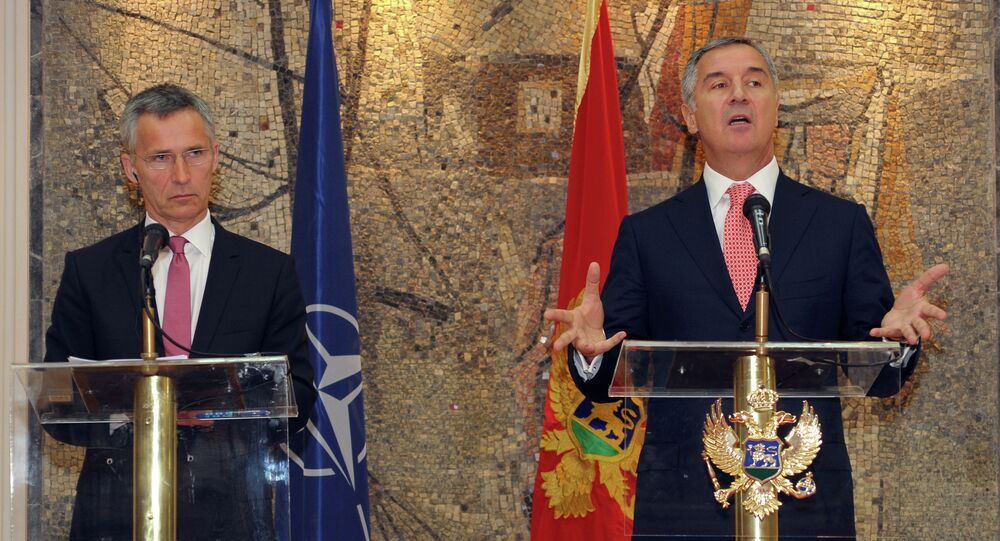 Montenegro's Prime Minister Milo Djukanovic, right, speaks and gestures after talks with NATO Secretary-General Jens Stoltenberg, in Podgorica, Montenegro, Thursday, June 11, 2015