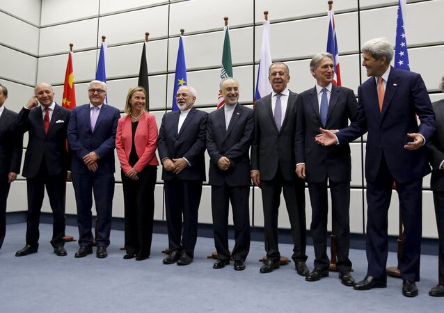 (From L to R) Chinese Foreign Minister Wang Yi, French Foreign Minister Laurent Fabius, German Foreign Minister Frank Walter Steinmeier, European Union High Representative for Foreign Affairs and Security Policy Federica Mogherini, Iranian Foreign Minister Mohammad Javad Zarif, Head of the Iranian Atomic Energy Organization Ali Akbar Salehi, Russian Foreign Minister Sergey Lavrov, British Foreign Secretary Philip Hammon, U.S. Secretary of State John Kerry and U.S. Secretary of Energy Ernest Moniz pose for a group picture at the United Nations building in Vienna, Austria July 14, 2015